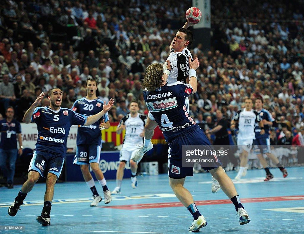 Dominik Klein of Kiel is challenged by Felix Loedank of Balingen during the Toyota Handball bundesliga match between THW Kiel and HBW Balingen-Weilstetten at the Sparkassen Arena on June 2, 2010 in Kiel, Germany.