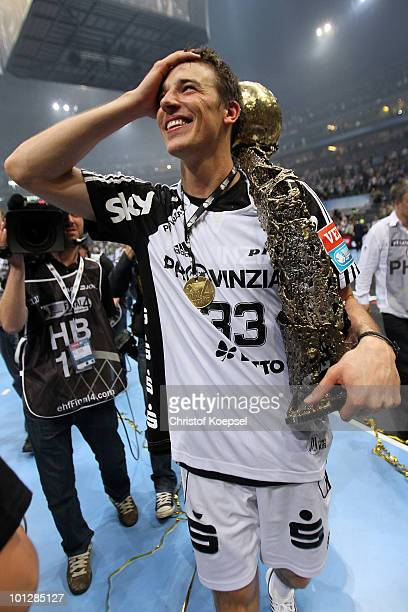 Dominik Klein of Kiel presents the winning trophy after winning the Champions League 3634 between THW Kiel and FC Barcelona Borges at the Lanxess...