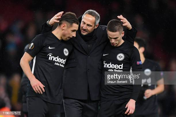 Dominik Kohr, Adi Hutter, Head Coach of Eintracht Frankfurt and Mijat Gaćinovic of Eintracht Frankfurt celebrate following their sides victory in the...