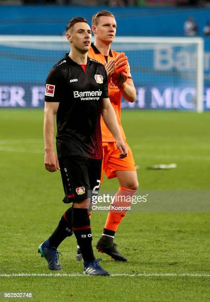 Dominik Kohr and Bernd Leno of Leverkusen look dejected after the Bundesliga match between Bayer 04 Leverkusen and VfB Stuttgart at BayArena on April...
