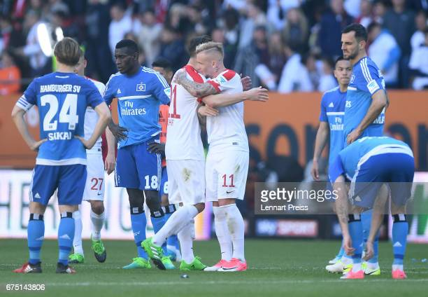 Dominik Kohr and Jonathan Schmid of FC Augsburg celebrate after the Bundesliga match between FC Augsburg and Hamburger SV at WWK Arena on April 30...