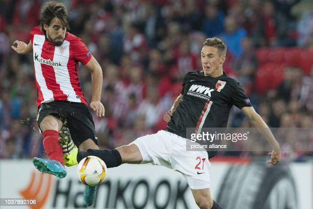 Dominik Kohr of Augsburg and Benat Extebarria of Bilbao vie for the ball during the UEFA Europa League Group L soccer match between Athletic Bilbao...