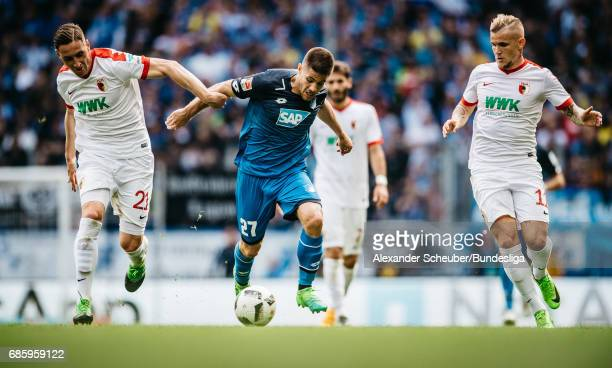 Dominik Kohr of Augsburg and Jonathan Schmid of Augsburg challenges Andrej Kramaric of Hoffenheim during the Bundesliga match between TSG 1899...
