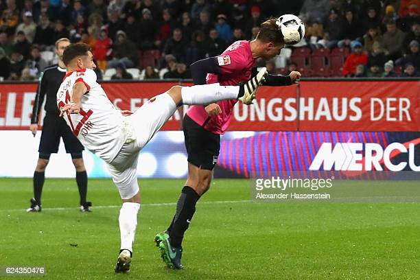 Dominik Kohr of Augsburg battles for the ball with Niklas Stark of Berlin during the Bundesliga match between FC Augsburg and Hertha BSC at WWK Arena...