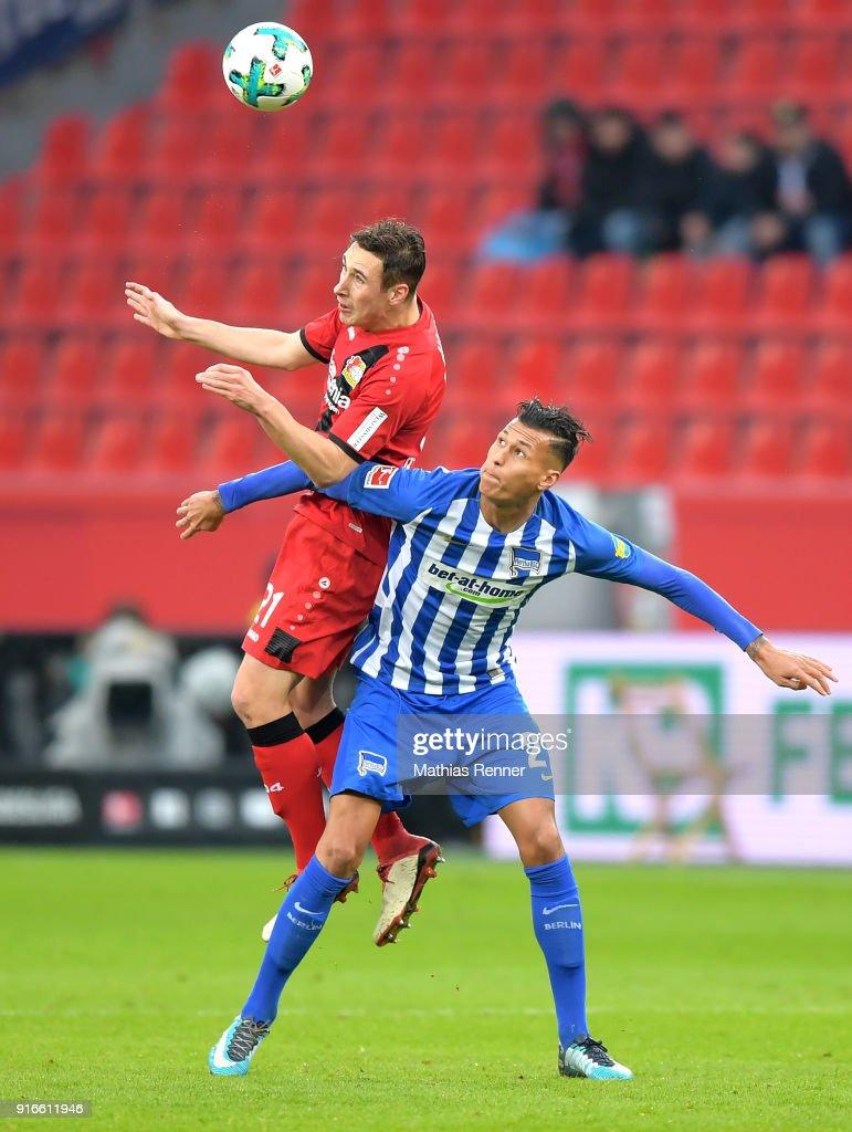Dominik Kohr of Bayer 04 Leverkusen and Davie Selke of Hertha BSC during the first Bundeliga game between Bayer 04 Leverkusen and Hertha BSC at BayArena on February 10, 2018 in Leverkusen, Germany.