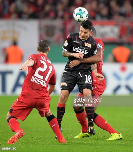 Dominik Kohr of Bayer 04 Leverkusen Philipp Hosiner of 1 FC Union Berlin and Jonathan Tah of Bayer 04 Leverkusen during the DFBPokal match...