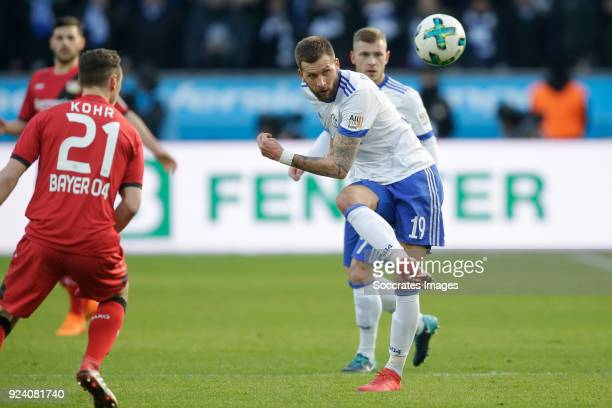 Dominik Kohr of Bayer Leverkusen Guido Burgstaller of Schalke 04 during the German Bundesliga match between Bayer Leverkusen v Schalke 04 at the...
