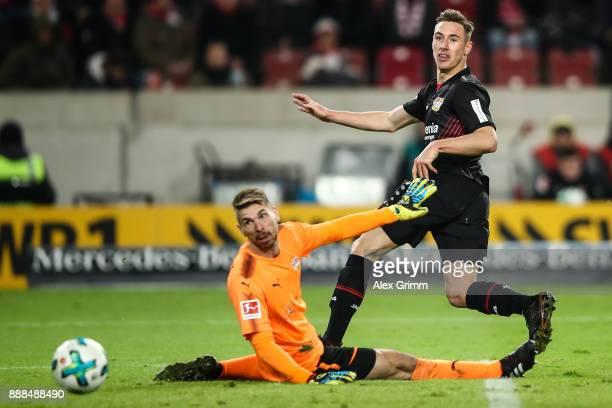 Dominik Kohr of Bayer Leverkusen misses the goal next to RonRobert Zieler of VfB Stuttgart during the Bundesliga match between VfB Stuttgart and...