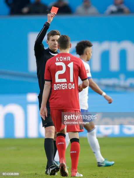Dominik Kohr of Bayer Leverkusen receives a red card from referee Siebert during the German Bundesliga match between Bayer Leverkusen v Schalke 04 at...