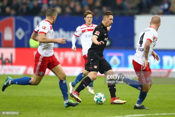 Dominik Kohr of Bayer Leverkusen runs through the defense of Hamburg during the Bundesliga match between Hamburger SV and Bayer 04 Leverkusen at...