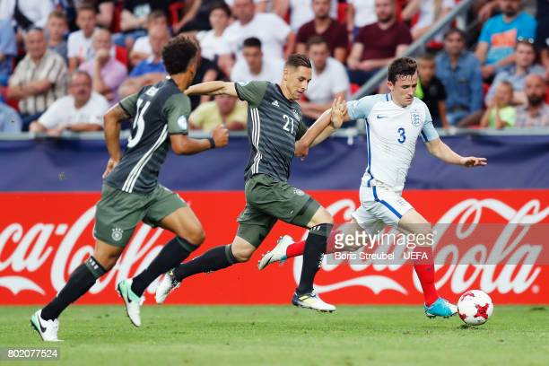 Dominik Kohr of Germany and Ben Chilwell of England battle for possession during the UEFA European Under21 Championship Semi Final match between...