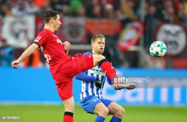 Dominik Kohr of Leverkusen and Arne Maierbattle for the ball during the Bundesliga match between Bayer 04 Leverkusen and Hertha BSC at BayArena on...
