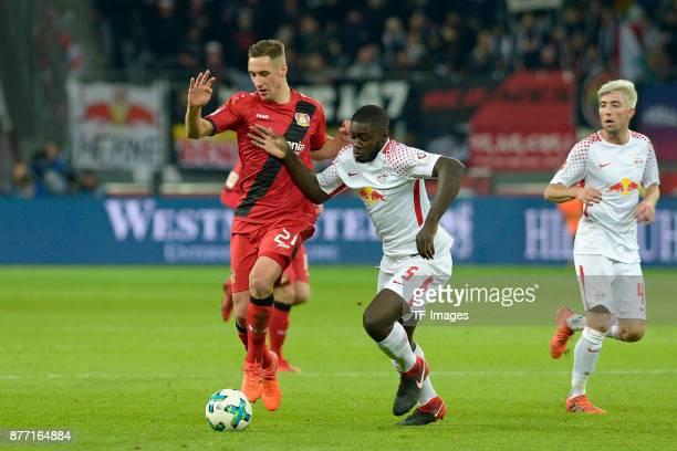 Dominik Kohr of Leverkusen and Dayot Upamecano of Leipzig battle for the ball during the Bundesliga match between Bayer 04 Leverkusen and RB Leipzig...