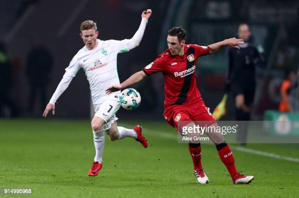 Dominik Kohr of Leverkusen and Florian Kainz of Bremen battle for the ball during the DFB Cup quarter final match between Bayer Leverkusen and Werder...