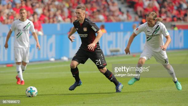 Dominik Kohr of Leverkusen and Iver Fossum of Hannover fight for the ball during the Bundesliga match between Bayer 04 Leverkusen and Hannover 96 at...