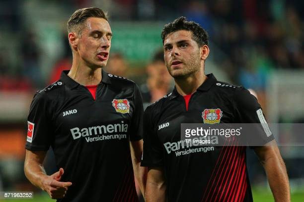 Dominik Kohr of Leverkusen and Kevin Volland of Leverkusen looks on during the Bundesliga match between FC Augsburg and Bayer 04 Leverkusen at...