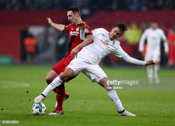 Dominik Kohr of Leverkusen and Max Kruse of Bremen battle for the ball during the DFB Cup quarter final match between Bayer Leverkusen and Werder...