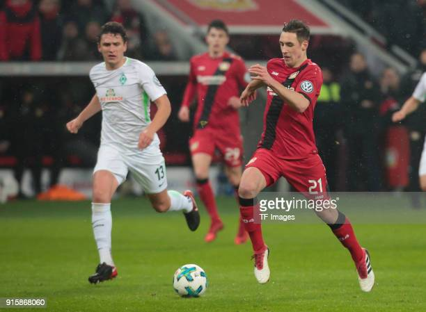 Dominik Kohr of Leverkusen and Milos Veljkovic of Bremen battle for the ball during the DFB Cup match between Bayer Leverkusen and Werder Bremen at...