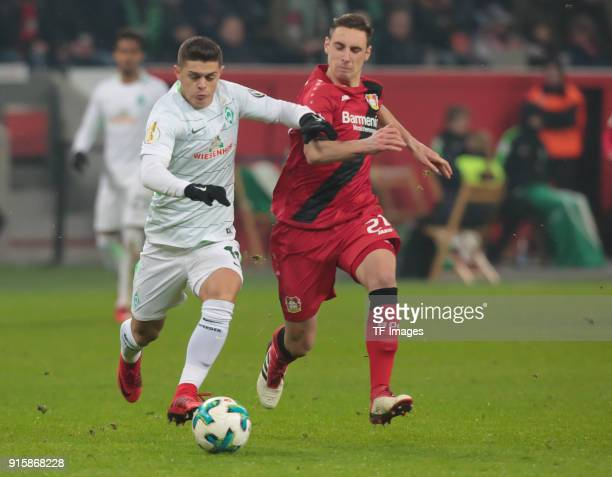 Dominik Kohr of Leverkusen and Milot Rashica of Bremen battle for the ball during the DFB Cup match between Bayer Leverkusen and Werder Bremen at...
