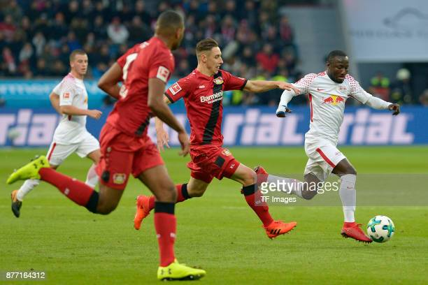 Dominik Kohr of Leverkusen and Naby Keita of Leipzig battle for the ball during the Bundesliga match between Bayer 04 Leverkusen and RB Leipzig at...