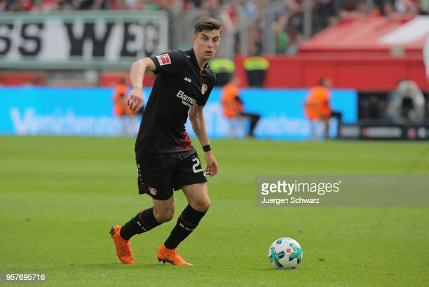 Dominik Kohr of Leverkusen drives the ball during the Bundesliga match between Bayer 04 Leverkusen and Hannover 96 at BayArena on May 12 2018 in...