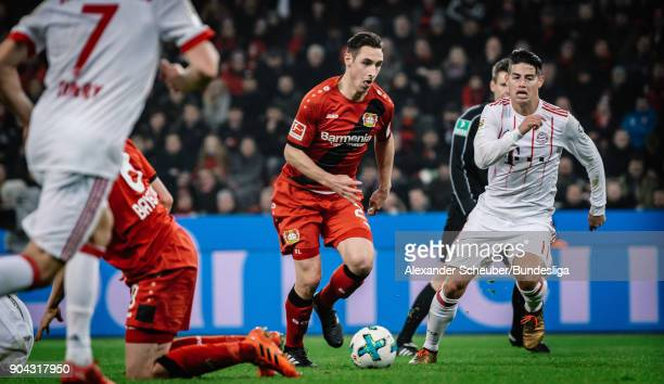 Dominik Kohr of Leverkusen in action against James Rodriguez of Bayern during the Bundesliga match between Bayer 04 Leverkusen and FC Bayern Muenchen...