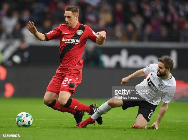 Dominik Kohr of Leverkusen is challenged by Marc Stendera of Frankfurt during the Bundesliga match between Eintracht Frankfurt and Bayer 04...