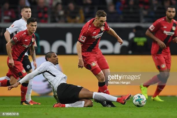 Dominik Kohr of Leverkusen is challenged by Sebastien Haller of Frankfurt during the Bundesliga match between Eintracht Frankfurt and Bayer 04...
