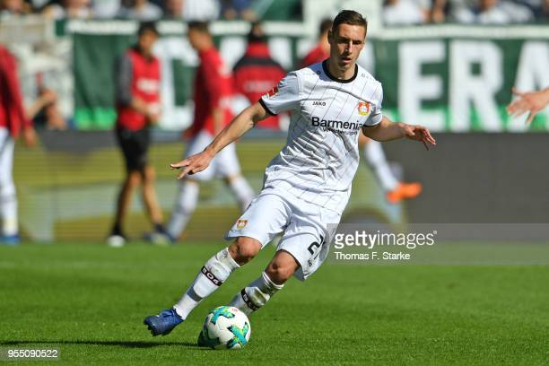 Dominik Kohr of Leverkusen runs with the ball during the Bundesliga match between SV Werder Bremen and Bayer 04 Leverkusen at Weserstadion on May 5...