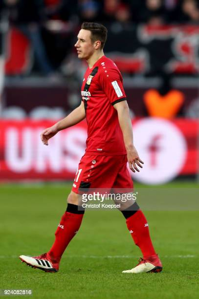 Dominik Kohr of Leverkusen walks off the pitch after his yellow red card during the Bundesliga match between Bayer 04 Leverkusen and FC Schalke 04 at...