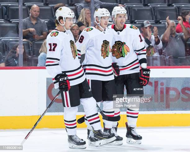 Dominik Kubalik of the Chicago Blackhawks celebrates his second period goal with teammates Dylan Strome and Brendan Perlini during a pre-season NHL...