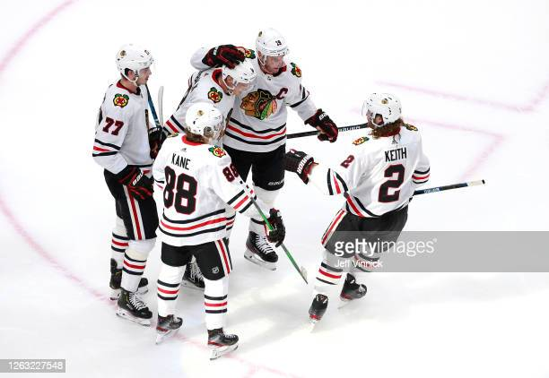 Dominik Kubalik of the Chicago Blackhawks is congratulated by teammates Jonathan Toews, Patrick Kane, Kirby Dach and Duncan Keith after Kubalik...