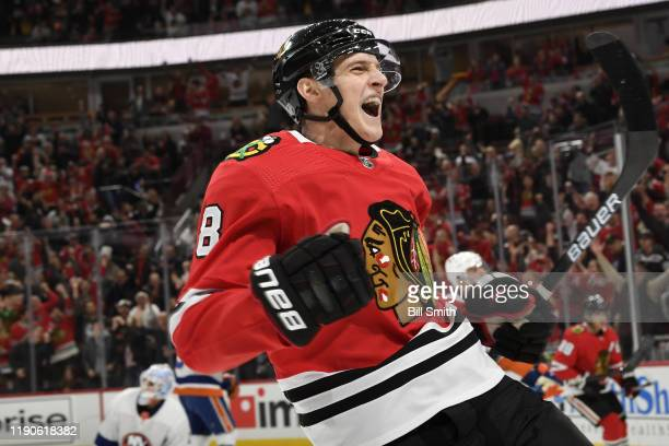 Dominik Kubalik of the Chicago Blackhawks reacts after scoring against the New York Islanders in the first period at the United Center on December 27...