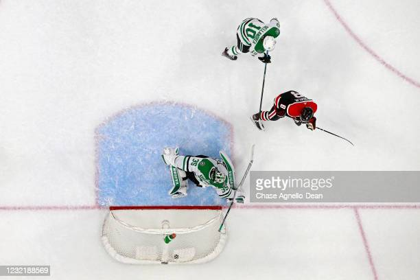 Dominik Kubalik of the Chicago Blackhawks scores a goal past Anton Khudobin of the Dallas Stars in the first period at the United Center on April 08,...