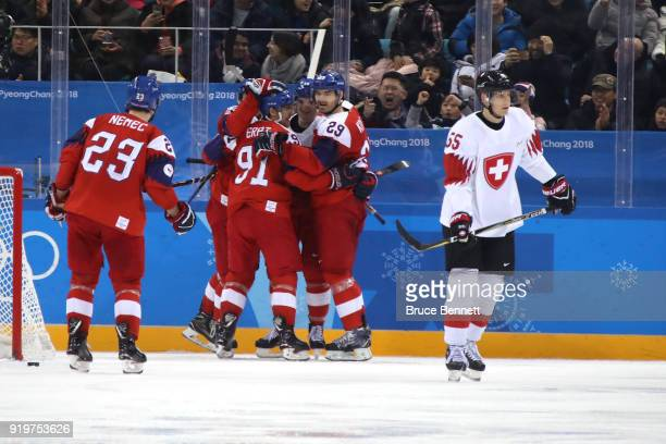 Dominik Kubalik of the Czech Republic celebrates with his teammates after scoring a goal on Jonas Hiller of Switzerland in the third period during...