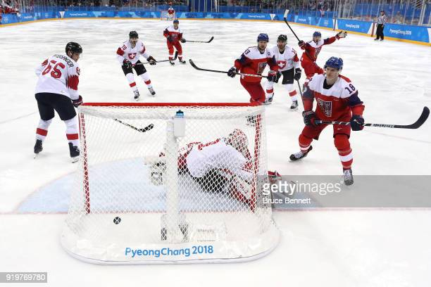 Dominik Kubalik of the Czech Republic scores a goal on Jonas Hiller of Switzerland in the third period during the Men's Ice Hockey Preliminary Round...