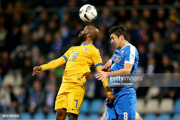 Dominik Kumbela of Braunschweig and Anthony Losilla of Bochum go up for a header during the Second Bundesliga match between VfL Bochum 1848 and...