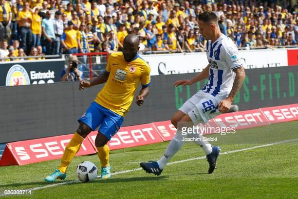 Dominik Kumbela of Braunschweig challenges Bjarne Thoelke of Karlsruhe during the Second Bundesliga match between Eintracht Braunschweig and...
