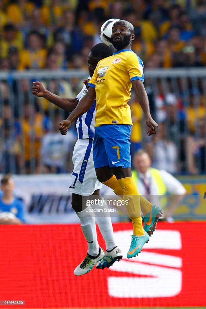 Dominik Kumbela of Braunschweig challenges David Kinsombi of Karlsruhe during the Second Bundesliga match between Eintracht Braunschweig and Karlsruher SC at Eintracht Stadion on May 21, 2017 in Braunschweig, Germany.