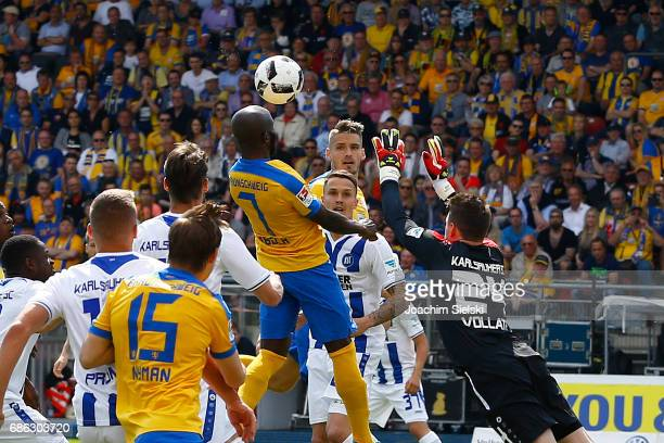 Dominik Kumbela of Braunschweig challenges Rene Vollath of Karlsruhe and shoot the Goal 10 during the Second Bundesliga match between Eintracht...