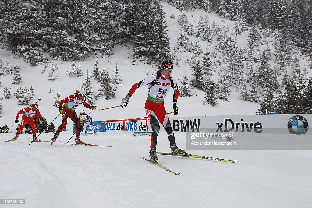 Dominik Landertinger (C) competes during the mens 10 km sprint event in the IBU Biathlon World Cup on December 10, 2010 in Hochfilzen, Austria.