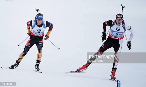 Dominik Landertinger of Austria overtakes Simon Schempp of Germany to win the men's 4x75km relay on day two of the EOn IBU World Cup Biathlonon...