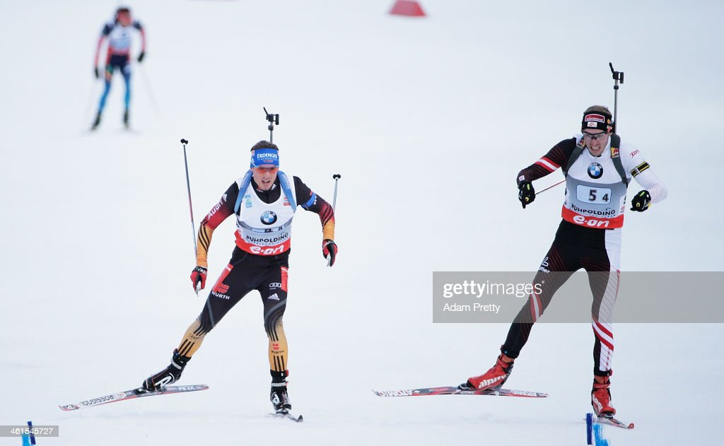 Dominik Landertinger of Austria overtakes Simon Schempp of Germany to win the men's 4x7.5km relay on day two of the E.On IBU World Cup Biathlonon January 9, 2014 in Ruhpolding, Germany.