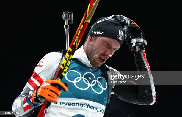 Dominik Landertinger of Austria reacts at the finish during the Men's 20km Individual Biathlon at Alpensia Biathlon Centre on February 15 2018 in...