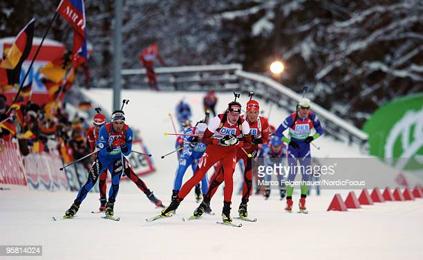 Dominik Landertinger of Austria Simon Fourcade of France and Alexander Os of Norway compete during the men's mass in the eon Ruhrgas IBU Biathlon...