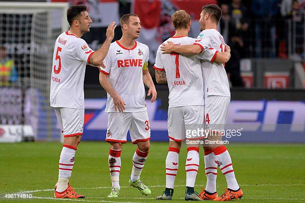 Dominik Maroh of Koeln celebrates with team mates after scoring the opening goal during the Bundesliga match between Bayer Leverkusen and 1 FC Koeln...