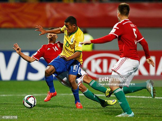 Dominik Nagy and Bence Lenzser of Hungary can not stop the attacking Gabriel Jesus of Brazil during the FIFA U20 World Cup New Zealand 2015 Group E...