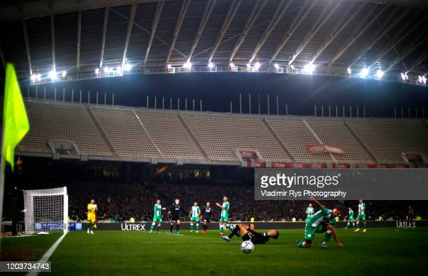 Dominik Nagy of Panathinaikos slides into Dimitris Giannoulis of PAOK during the Greece SuperLeague match between Panathinaikos FC and P.A.O.K. At...