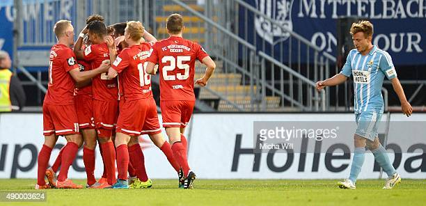 Dominik Nothnagel of Wuerzburg celebrates with teammates after scoring the opening/first goal during the Third League match between Wuerzburger...