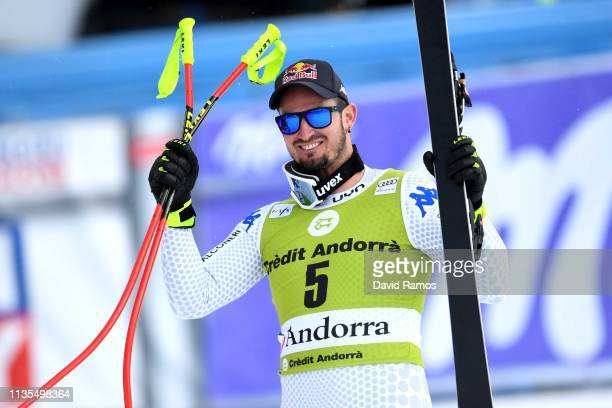 Dominik Paris of Italy celebrates winning the Men's Downhill after the Men's Downhill on March 13 2019 in Andorra la Vella Andorra